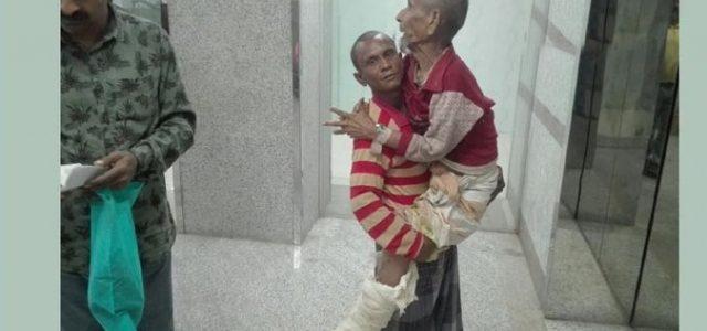 ২০০ টাকা নেই ট্রলিও নেই, তাই বুড়ো বাবাকে কোলে নিয়ে ছুঁটছেন ছে'লে